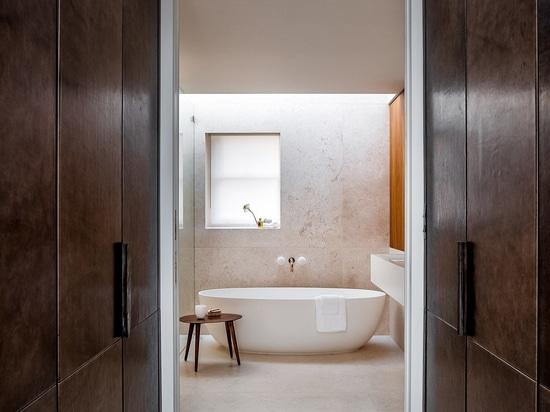 Sliding doors lead into the master bathroom