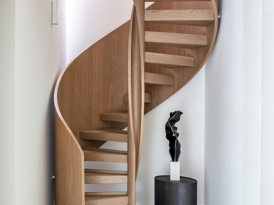 A helical staircase connects the three floors
