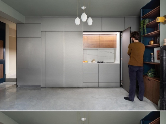 This Kitchen Was Designed To Hide Behind A Wall Of Minimalist Cabinets