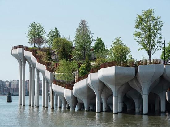 "The precast concrete planters are formed of modular ""petals"""