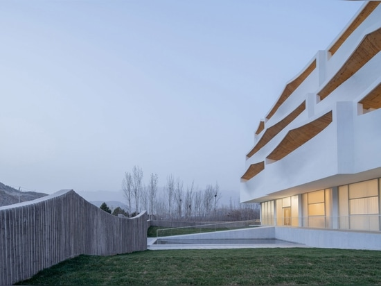 A fence mimics the shape of the terraces