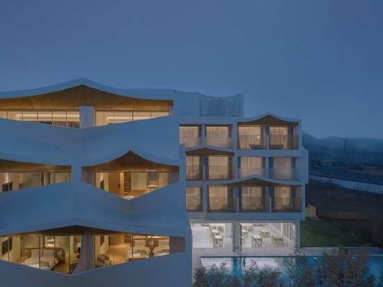 Pitched roofs span the facades of the hotel