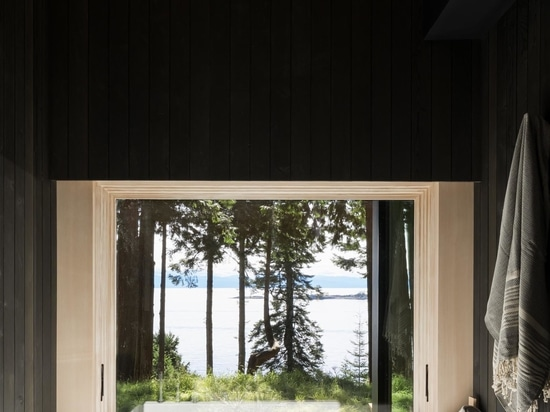 With A Dark Exterior And A Light Interior, This Rural Home Is Clad With Cedar Inside And Out
