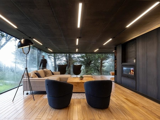 The extension is surrounded by glass walls