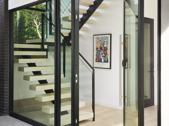 SLIC Design Creates a Modern Glass House That Rises to the Treetops