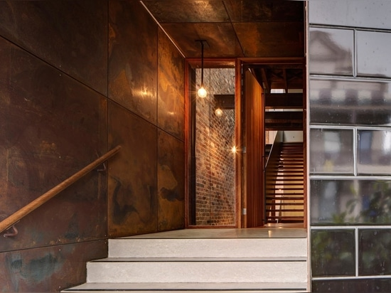 Glazed Black Tiles Present A Sophisticated Exterior For This Home That Used To Be A Warehouse