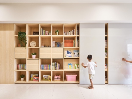 A Sliding Whiteboard Is A Key Feature Of This Shelving Unit Designed For Kids