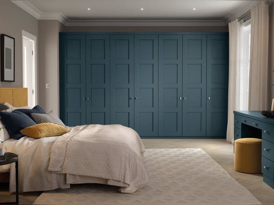 Blue Fitted Space-saving Wardrobes by Neville Johnson.