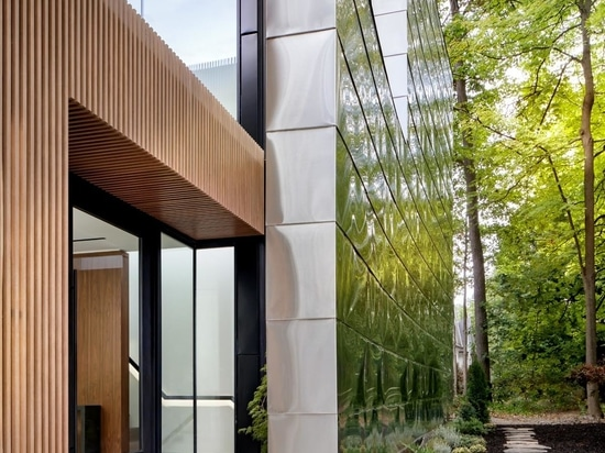 A 40 Foot Glass Wall Folds Open To Connect The Interior And Exterior Spaces Of This Home