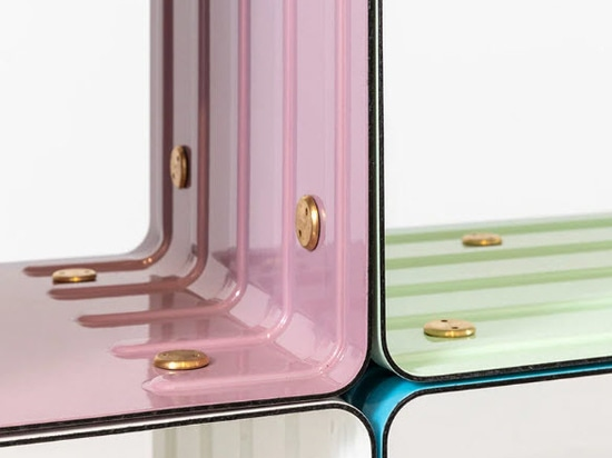 the curved steel sheets envisioned as a canvas feature a vitrified and colored enamel