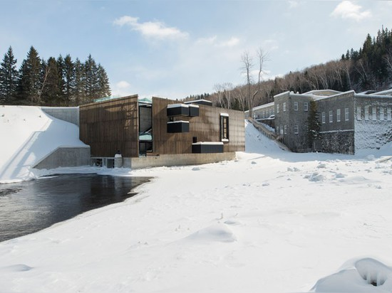 Atelier pierre thibault punctuates hydroelectric plant with loggias in quebec
