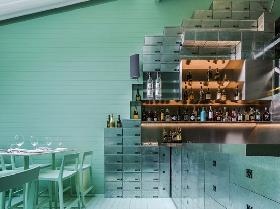 zinc shoeboxes comprise the shelving and counter bar area of the eatery