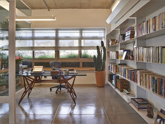 the steel axis ends in the home office where it turns into a library