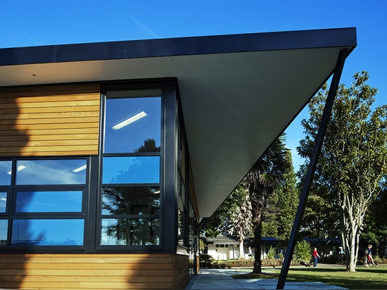 natural, crisp materials are a reflection of the building's context