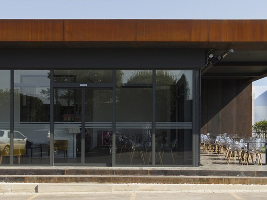 Muum's D Cafe in Turkey is a flexible daylit space wrapped in recycled metal plates