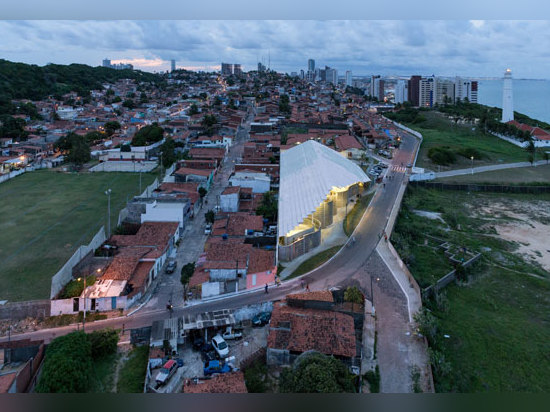 The Arena do Morro stands out from the fine-grained, colourful favela structure due to its size and bright appearance. It creates a new public space that is visible from a great distance; photo: Iw...