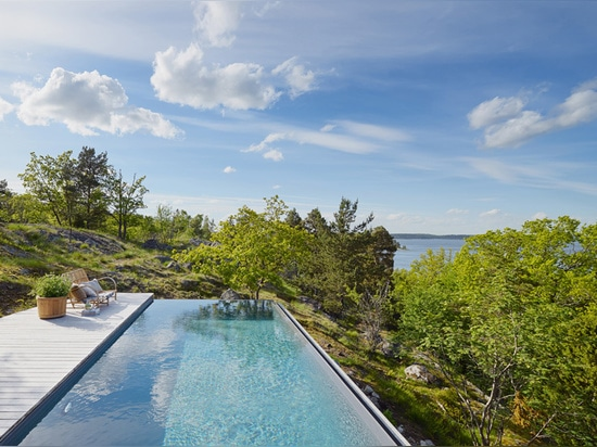 the dwelling looks out over the treetops towards the stockholm archipelago