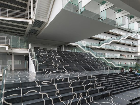 The centerpiece of the campus is an expansive 9,687 sq ft staircase composed of black granite and white resin