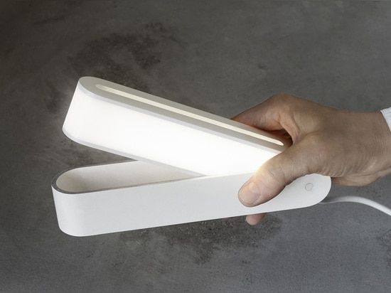 THIS TINY LAMP TURNS OFF WHEN FOLDED SHUT