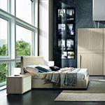 cama de casal / contemporânea / estofada / com cabeceira em couro