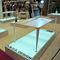 mesa contemporânea / em Corian® / para estabelecimento público / luminária