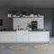 cozinha contemporânea / em laminado / com ilha / lacada